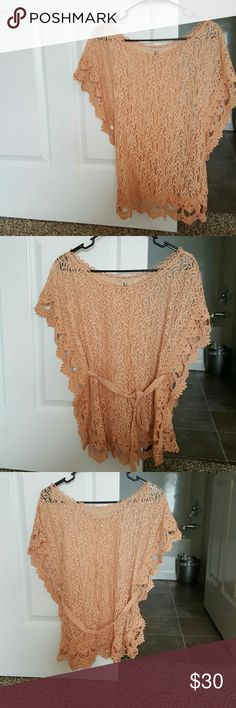 Beautiful Peach Lacy Top With Belt Peach lace like material. Beautiful on the sides and bottom with a larger scale design. This is ment to have something, no matter what it might be underneath. Bought it on line and its too small on me. New without tags. Never worn at all. lost Tops Blouses