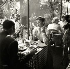 "Mexican Holiday: 1953  ""Actress Audrey Hepburn with dining companion in Mexico."" From photos by Earl Theisen for Look magazine."