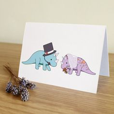 This card is perfect for any dinosaur lover on their wedding day. It features two Triceratops all dressed up for their big day! The mint one