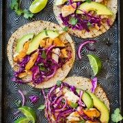 Dress up tilapia fillets with a quick trip to the grill and irresistible taco toppings including avocado and red-cabbage slaw. Grilled Fish Tacos, Salmon Tacos, Grilled Salmon, Fish Tacos With Cabbage, Cabbage Slaw, Red Cabbage, Vegetarian Fried Rice, Slow Cooker Enchiladas, How To Make Oil