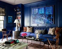 Deep blue paneled library design by Thom Filicia. More reasons to say yasss to a blue sofa: http://www.sarahsarna.com/blue-sofa/