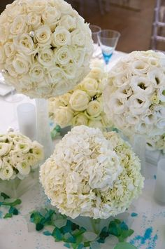 Assorted white pomanders as center pieces