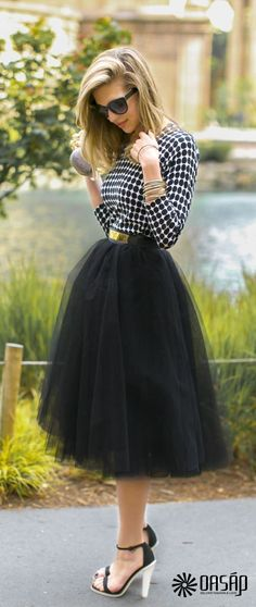 """This particular length in a skirt is not too common. Skirts and dresses that extend below the knee aren't generally seen in today's fashion, but was incredibly popular before the 1920's. In the 1920's women pushed for """"short"""" skirts (skirts that went to the knee). This particular skirt definitely incorporates inspiration from fashion before 1920, as both the length and the empire waist cause the onlooker to reminisce about fashion from this time period. -Marissa Smith"""