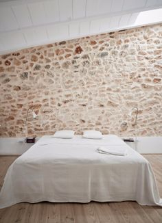 Love the stone wall behind this bed.  It's sure to provide a cooling backdrop on hot summer evenings.
