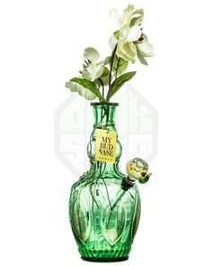 Love this beautiful green glass flower vase bong pipe