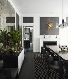 Greg chose grey grass cloth wallpaper to offset this Melbourne dining room's expansive white walls and ceiling.