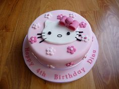 A very special pink fondant cake for a little girl with pink fondant bow and Hello Kitty fondant cut-out. Bolo Kitty, Bolo Da Hello Kitty, Hello Kitty Fondant, Hello Kitty Cupcakes, Hello Kitty Torte, Hello Kitty Birthday Cake, Cake Birthday, Happy Birthday, Birthday Cakes Girls Kids