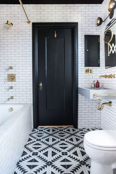 Small bath by Katie Martinez. Black, white & brass. Something retro in feel with white subway tile, dark grout and brass plumbing fixtures. Then there's the very modern vanity light fixture, geometric bold black 'n white diamond patterned tile and art deco style mirror. Lots of eras and textures mixed in one room that really works. The key here is color that ties everything together.  I guess the tip would be…where you are mixing styles make sure to keep your colors and accents consistent…