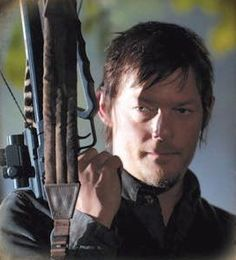 Norman Reedus Daryl Dixon The Walking Dead - The man looks badass with his crossbow.