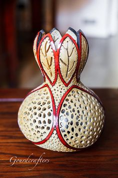 Autumn Glow Gourd Lamp Made from a medium bottle gourd. It is pyroengraved, hand dyed and drilled to create the lovely patterns on the gourd and the light effects it casts on the surrounding area. Each lamp is fully outfitted and wired. Please specify if intending for use in UK or