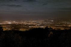 "Guatemala City at night from ""El Mirador"" on the steep winding road down the Pan-American highway into Guatemala City. We stopped for a Coke and got a table at the edge of the lookout and I took it from there. Just north of Guatemala City."