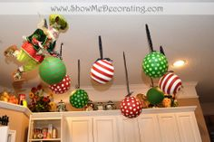 Feather tree on the Kitchen table Shows off many vintage Mary Engelbreit ornaments
