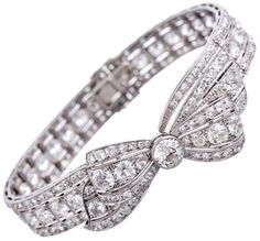 Marvelous Convertible 1950s Platinum Diamond Bow Bracelet, via @1stdibs. An absolutely charming piece of 1950s treasure. Beautifully constructed with excellent execution, the center is a gently curved bow with a bezel-set old European cut diamond of approximately .80 carats. Additionally, a total of 12 carats of diamonds provide a spectacular backdrop for this gorgeous piece. The bow has a lifelike, almost undulating feeling and can be detached from the bracelet and worn as a pin.