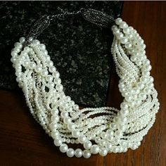 """Chunky Braided Pearl Statement Necklace Cream / white faux pearl chunky necklace.  Strands are braided with two links of rhinestones for added glam. Adjustable size. 19"""" - 21"""" length. Gorgeous formal or business accessory! Brand new! Jewelry Necklaces"""