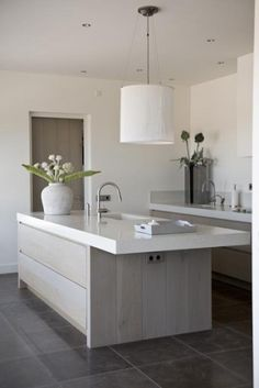 chalky white kitchen with taupe and slate accents