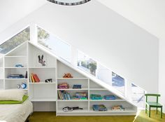 Part of this Australian home was designed around its pitched bookcase, which follows the roofline. The homes pictured here were both designed by Dutch firm EventArchitectuur. The company takes an artistic approach to their creative bookcases by inventing elaborate spaces that cover interior walls from room to room. Various shapes and sizes are intermingled for unique architectural interest.