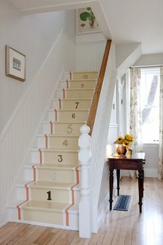 Sarah Richardson's Cottage - painted staircase runner with found house numbers.
