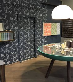 The Paint Makers Co. showroom.  Wall decorated with a stencil and painted with: color n. 101 A Blue Point of View  color n. 32 You cannot buy class Paint and floor resin for design lovers.  #dark #color #trend #storedesign #retaildesign
