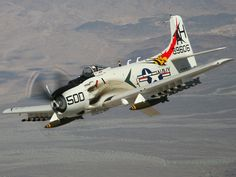 Navy A1h Skyraider, Viet Nam war era. The two larger bombs are napalm.