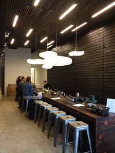 inexpensive wall covering for tea bar Book Bar, Coffee Places, Coffee And Books, Merchandising Displays, Environment Design, Architecture, Tea Houses, Interior, Table