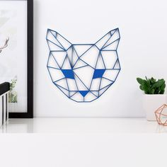 Katzenkopf Origami Figur aus Holz in vielen verschiedenen Farben erhältlich.