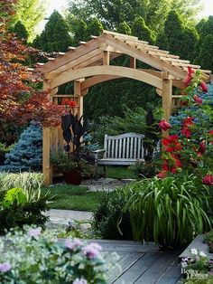 A pergola is adaptable enough that it can be used in a range of structures -- for example, this charming and cheerful seating structure. Used in this way, a pergola adds a focal point to a garden. A few containers help to soften and disguise the structure's base. #OutdoorsLiving