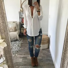This is the perfect button down blouse. Made of soft rayon fabric. Drapes beautifully over the body with a high low detail. Model is wearing Small.