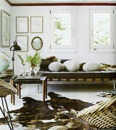 white living room, framed botanicals, cowhide elle decor, may 2012