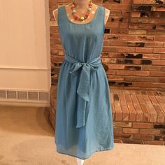 """Coldwater Creek teal blue dress Body 74% Lyocell, 26% nylon. Lining 100% cotton. Has attached sash that can be tied in front or back. Looks better tied in front. Machine wash. Made in China. Measures 19"""" from armpit across, 17"""" from to shoulder seam to waistline, 26"""" from waist to bottom of hem for a total of 43"""" long. Never worn. Perfect for bold statement jewelry or minimalist look. Coldwater Creek Dresses Midi"""