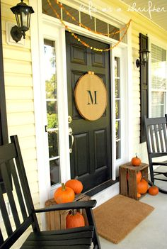 LOVE, LOVE, LOVE this fall front door!  Large embroidery hoop, burlap, pumpkins, crates,  and dot garland.
