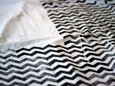 Tutorial for printing/stamping your own chevron print fabric!! Agh. Probably not up for this but I think it's awesome!! Way cheaper than any chevron fabric I've found to buy and the irregularity of it gives such a unique touch!