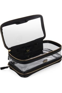 Black patent-leather (Cow), transparent PVC Two separate 'Take Off' and 'Touch Down' stamped compartments, signature bow at top, gold hardware Internal elasticated bands to secure products Zip fastenings with tassel zip pulls