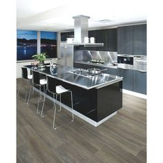 Laminate flooring in smooth-grey and light sand colors with an elegant finish.