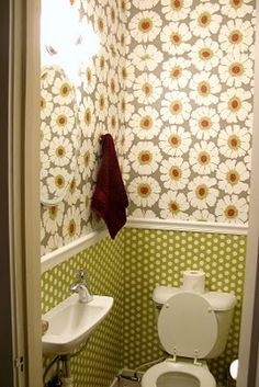 Turn a closer into a [powder room]. Small sink! wrapping paper!? Applied with modge podge!?