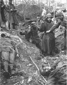 German soldiers surrendering to the soviets after a gunfight.