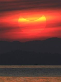 The same Ring of Fire of 20/05/2012, but seen partial during sunrise in the coastal town of Gumaca in the Philippines