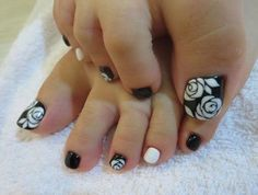 A black and white themed rose toenail art. Start out with a matte black base and add details of white roses on top completing this classic yet an all time favorite design. Toenail Art Designs, Cute Nail Art Designs, Toe Nail Designs, Fall Nail Designs, Pedicure Designs, Green Nails, Pink Nails, Flower Toe Nails, White Toenails