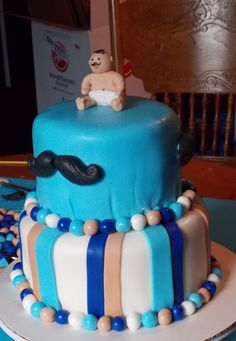 mustache baby shower cake but I'd do the baby a bit different...