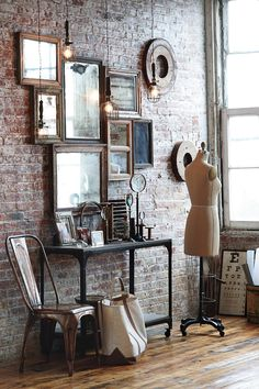 mirror collage, brick wall, pendant lighting