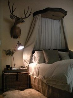 the perfect bedroom for a regal hunting lodge... this would be perfect for our master bedroom for me to cope with Jared's deer head