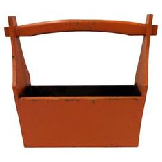 """Handcrafted wood bucket with a curved handle.  Product: BucketConstruction Material: Solid pine woodColor: OrangeFeatures:  Handle for easy liftingLightly distressed Dimensions: 13"""" H x 14"""" W x 6"""" D Note: Wipe down with lemon oil for beautiful shine"""