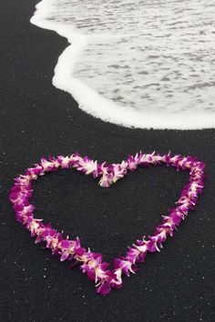 Hawaiian Lei on the famous black sands of Hawaii.  What a beautiful combination.