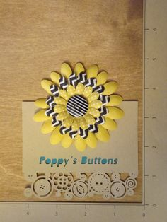 Yellow and Black Pattern Button Flower Barrette by PoppysButtons on Etsy