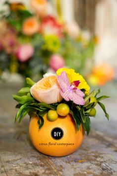 DIY centerpiece: http://www.stylemepretty.com/living/2015/05/07/diy-citrus-floral-centerpiece/ | Photography: Courtney Paige - http://www.courtneypaigephotography.com/
