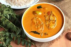 (Kerala style fish mango (meen manga curry) curry.Fish cooked in a coconut milk  based gravy with mangoes)