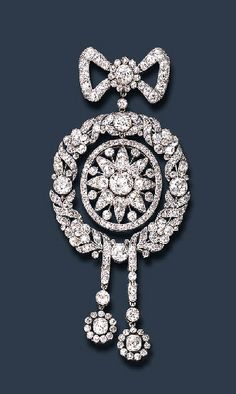 AN EXQUISITE BELLE EPOQUE DIAMOND BROOCH, BY CARTIER   Of garland motif, the old European-cut diamond bow enhanced by a diamond collet cluster knot, joined by a diamond collet to an old European & rose-cut diamond laurel wreath of oval outline, suspending staggered old European-cut diamond articulated ribbon motifs, with diamond collet cluster terminals, centering upon an independent old European & rose-cut diamond plaque of sunburst design, mounted in platinum, c 1908  Signed Cartier, Paris