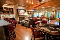 rustic game room this is so perfect . Exactly what I want in style for the game room. Love the wood ceiling cannot wait for our wood ceiling! Cubes, Rustic Games, Attic Bedroom Designs, Restaurants, Game Room Basement, Basement Ideas, Video Game Rooms, Man Cave Home Bar, Game Room Design