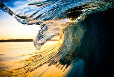 Inside the barrel of a wave (there are more gorgeous pics at the link)