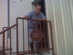 Tito at the bottling room door