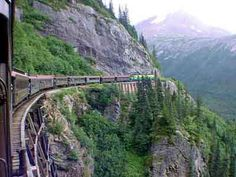 The White Pass and Yukon Railroad was built at the turn of the century (1898-1900) to connect Skagway with Whitehorse, Yukon, Canada. Prior to the completion of the railroad prospectors would climb the White Pass Trail from Skagway up into the Yukon's promising gold fields.